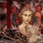 staty huvud kvinna ljuslykta rött